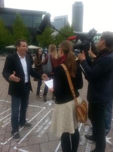 Hugh Being Interviewed by Media