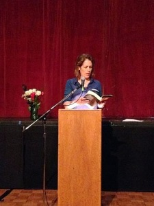Kelly Armstrong, reading from OMENS, during a past Night Out.